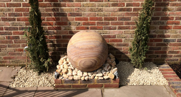 Sandstone sphere water feature
