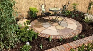 Contemporary design indian sandstone circle with brick edging