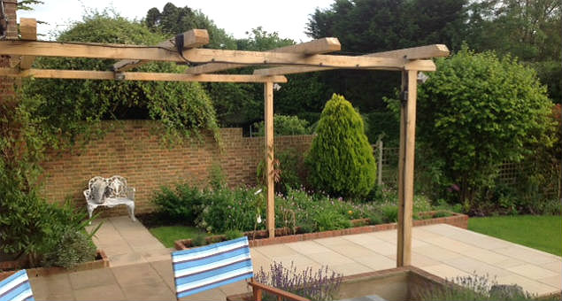 Arbour and low raised beds